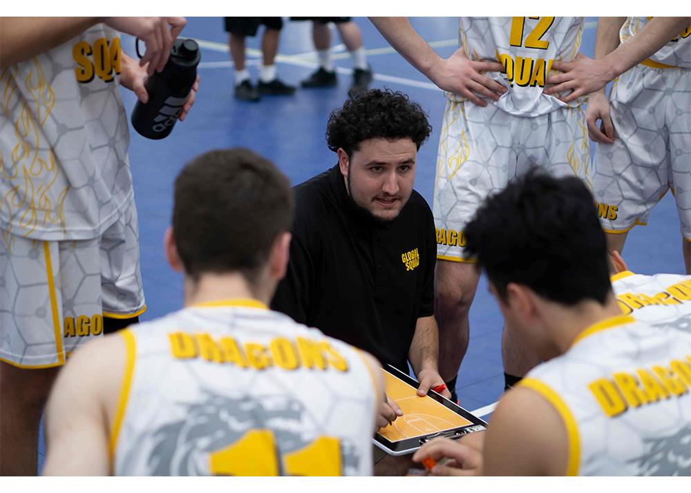 Coach Adam coaching kids